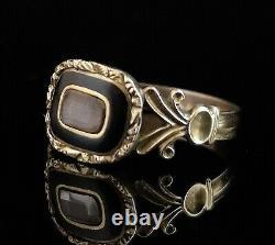 Antique Georgian mourning ring, hairwork, black enamel, 12ct gold