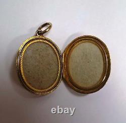 C. 1900 Antique 15 Karat (15k) Gold Oval Locket with Black Enamel