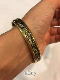Hermes Black And Gold Enamel Bangle With Perfume Bottle Design